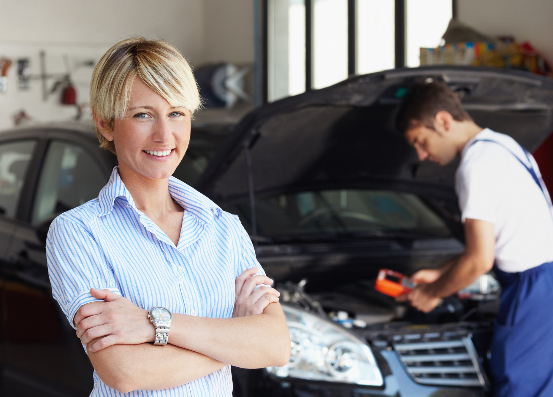 motor mechanics servicing a car